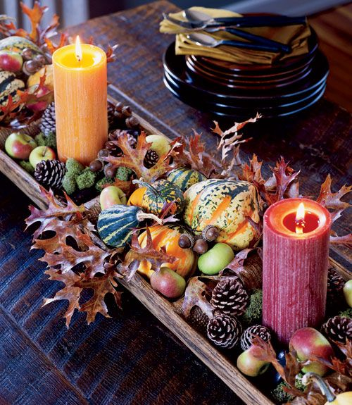 A long, low centerpiece such as this looks as pleasing on an entry table or sideboard as it does on the dining table. It's also great for parties since it doesn't obscure seated guests' views or obstruct the passing of food. Fill with an array of gourds, pinecones, leaves, or apples.
