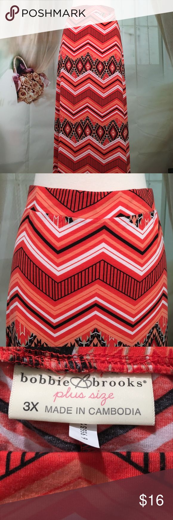 Bobbie Brooks Aztec Maxi Skirt NWOT Love the skirt. Orange and black Aztec pattern maxiskirt. 95% polyester and 5% spandex. Fabric is very soft. Elastic waist.  Wide band.  Slit in the back.  New without tags.  Size 3X.  Waist measured flat 20 inches and length 42 inches.  SK131 LOC-1 Bobbie Brooks Skirts Maxi