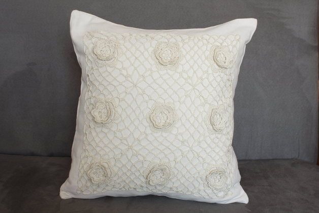 cream pillow with flower-patterned crochet lace