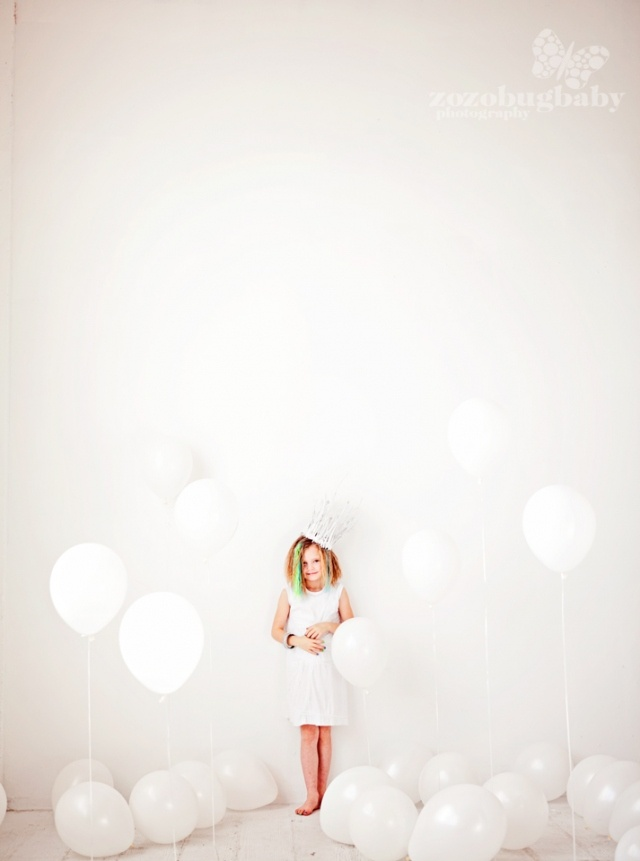 Love just the simplicity of the white balloons and white background.