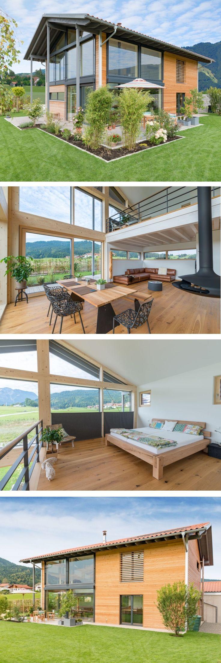 Einfamilienhaus modern im Alpenstil mit Holz Fassade, Satteldach Architektur & I…