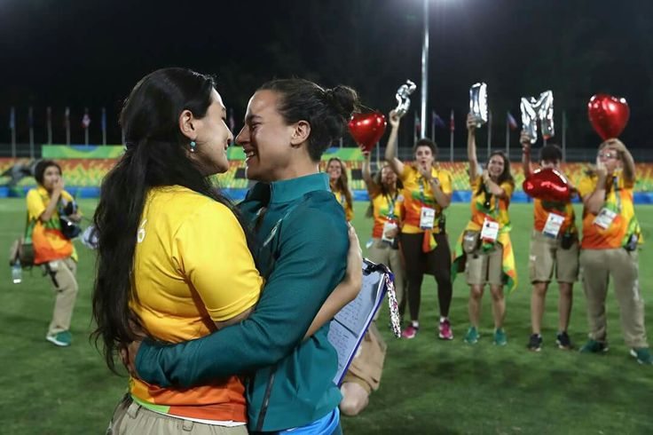 RIO DE JANEIRO, BRAZIL - AUGUST 08: Volunteer Marjorie Enya (L) and rugby player Isadora Cerullo of Brazil smile after proposing marriage after the Women's Gold Medal Rugby Sevens match between Australia and New Zealand on Day 3 of the Rio 2016 Olympic Games at the Deodoro Stadium on August 8, 2016 in Rio de Janeiro, Brazil. (Photo by Alexander Hassenstein/Getty Images)