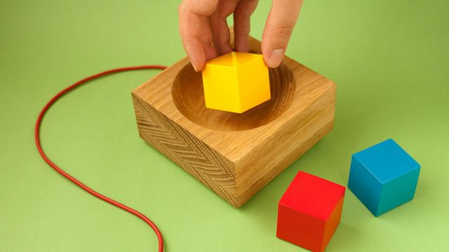 Skål by Timo. Skål is a media player designed for the home that lets you interact with digital media using physical objects. You place objects in a wooden bowl to play back related media on the TV. Skål makes media playful. http://www.skaal.no