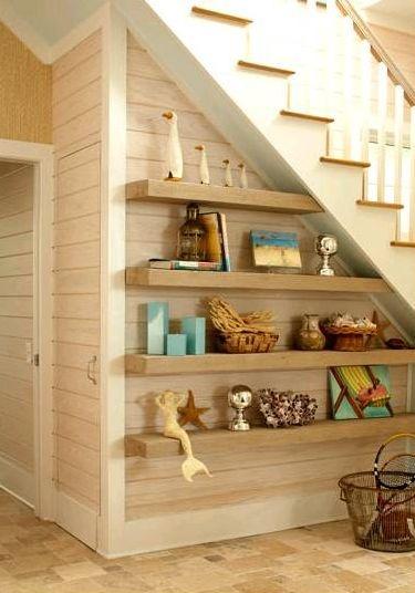 basement: book shelves under stairs