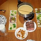 Made the BEST three cheese fondue on Saturday with Gruyere, Emmentaler, and sharp cheddar. Don't worry, I dumbed it down by dipping Kettle chips. Delish!