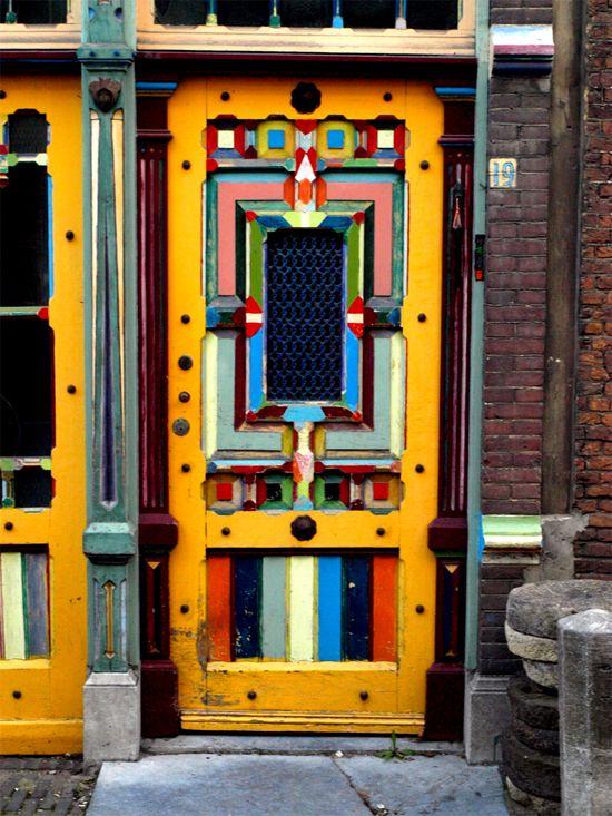 Love this bright cheery multi-colored door