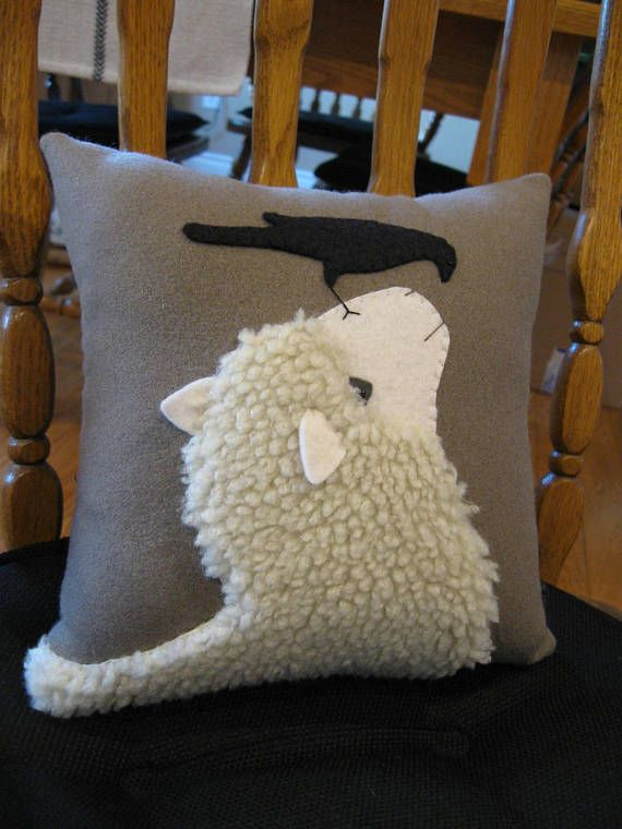 I saw a photograph similar to this scene and just fell in love with it! Such a lovely picture and touching design of a sheep and crow looking at each other. Ive used a woolly fabric for the sheep and added his face and ears in a cream colored wool felt. The ears are 3 dimensional. The