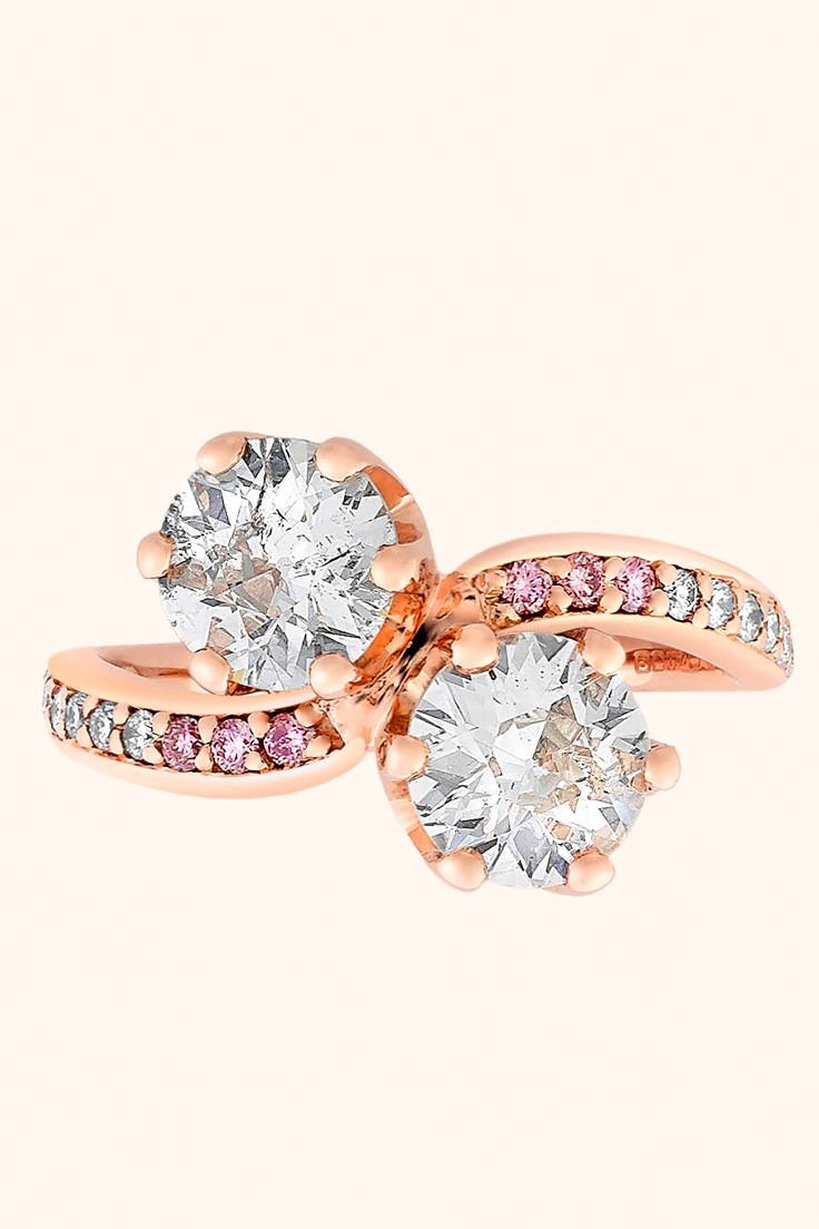 A sign of your love crafted to last a lifetime by Taylor & Hart. Create a design inspired by this beautiful ring with a European cut diamonds set in a 'moi et toi' style with bead-set fancy-pink and white diamonds in the band. Set in 18 carat rose gold.