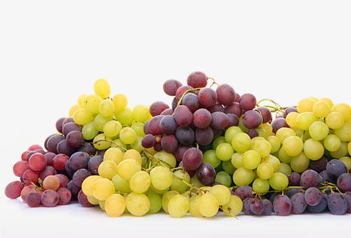 Grapes are a delectable low-calorie snack or dessert. One cup contains about 104 calories and is packed with vitamins C and K. Raisins (dried grapes) are also a good source of iron. Try to avoid imported grapes, which often have higher pesticide residues, but don't eliminate them from your diet if you can't always buy organic. Consider buying organic grapes for children and if you're pregnant.