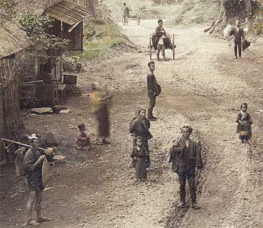 1890's. detail of Sanmaibashi on the Tokaido. A beautiful view on a rural road near Sanmaibashi (三枚橋) in Yumoto (湯本), Hakone. The photographer (Nobukuni Enami) has caught the attention of a group of children, women, farmers and travelers standing on the road. They are clearly very curious. Located in Kanagawa Prefecture, not too far from Yokohama, Hakone was—and still is—a popular spa resort.