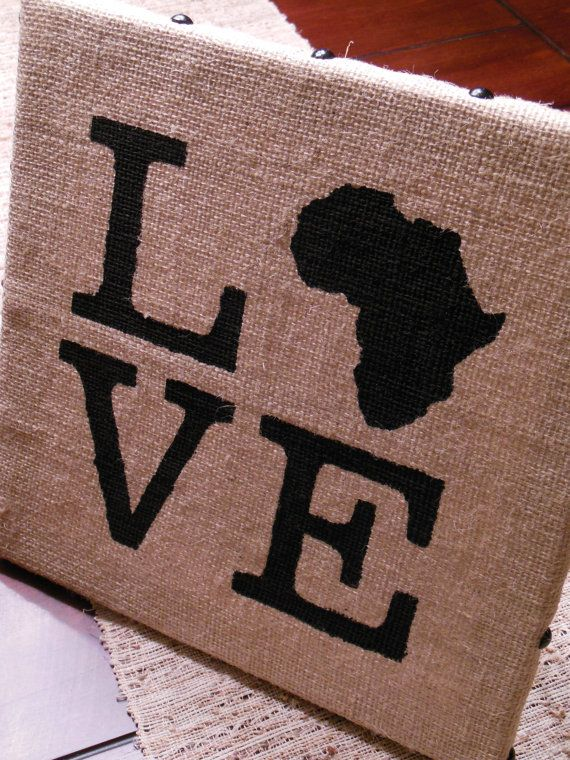 Show Love for Africa with this 12x12 Love Africa Painting on Burlap Canvas Art. Burlap is wrapped around a 12x12 canvas. Decorative