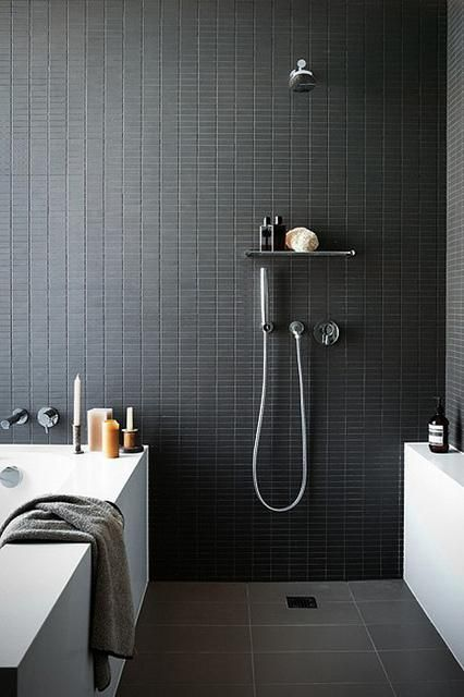 Feature panel on the shower wall in a wet room - go dark to give a classy adult feel