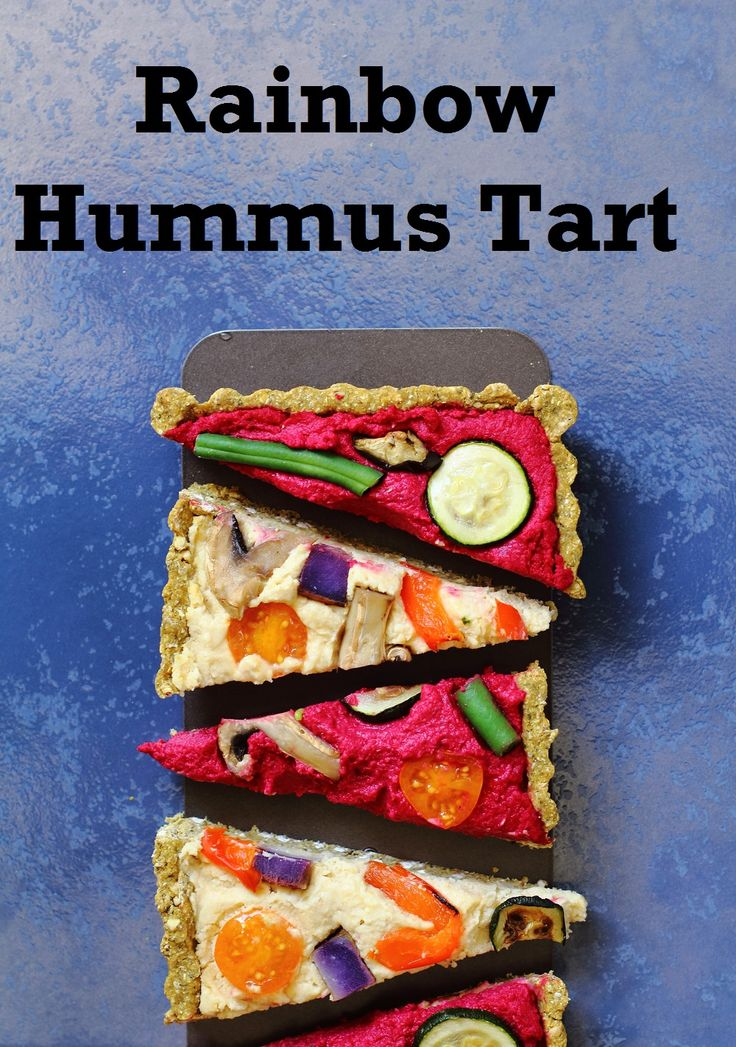 Tart filled with beetroot and plain hummus topped with colourful roast veggies