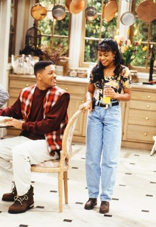 Tatyana Ali wears high-waisted jeans and a body in The Fresh Prince of Bel-Air