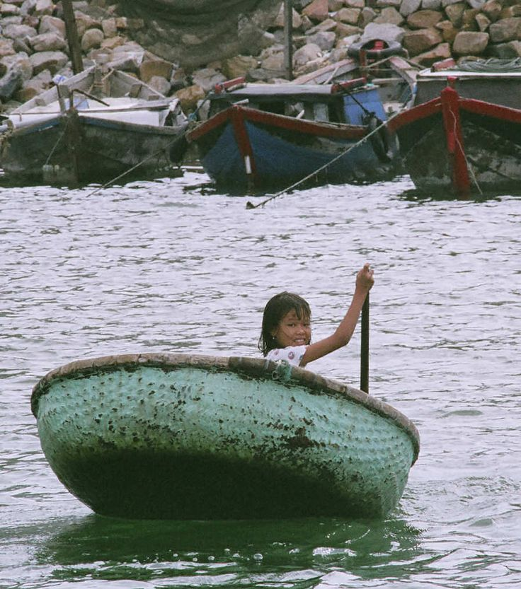 Riding in a basket boat, Vietnam