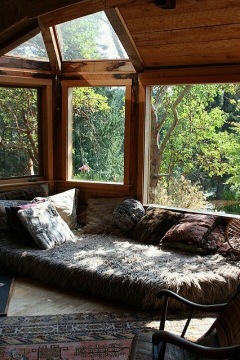 lots of light! wood panels, cozy den, floor mattress for lounging and relaxing, reading room, lots of pillows, great rugs, rocking chair, old world, vintage, rustic, gypsy den