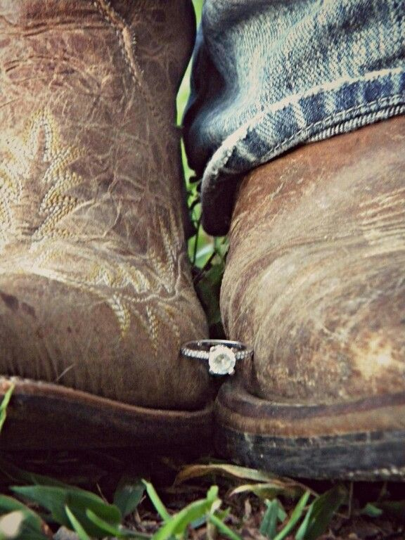 Unusual and cute engagement photo idea - hold the ring between his and her boots :)