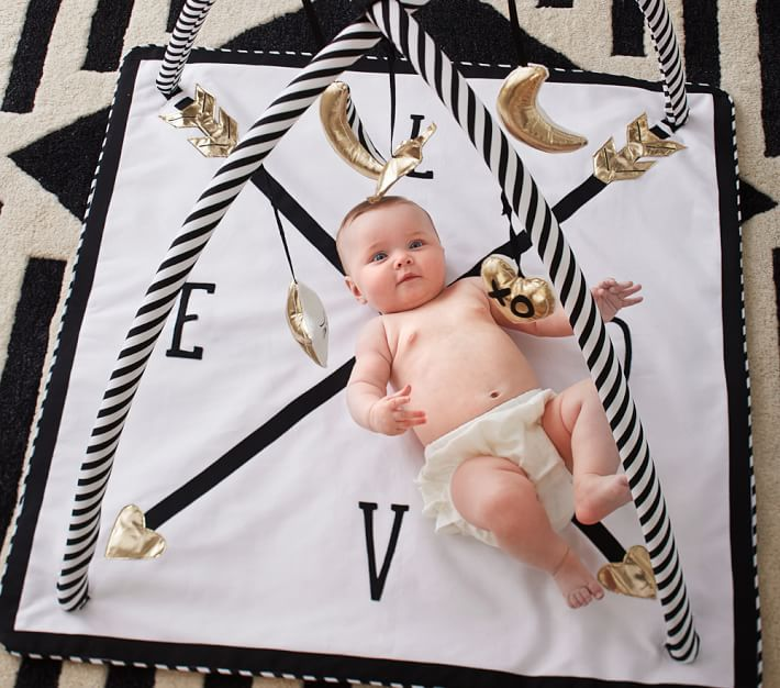 With black, white and gold stars and moons to see, feel and grab, this activity gym entertains and stimulates your baby during playtime. Imagined with fashion designers Emily Current and Meritt Elliott, it captures their bold aesthetic.