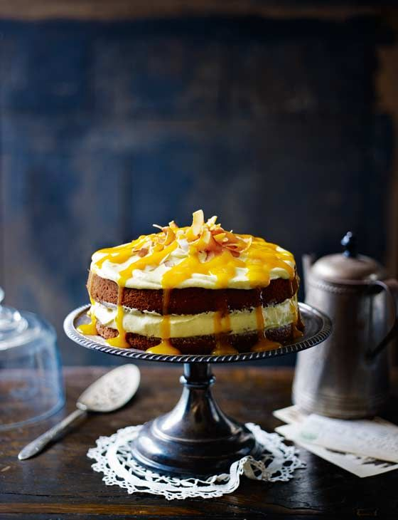 Coconut cake with mango cream cheese frosting and mango drizzle | This incredible drizzle cake from Miranda Gore Brown is simply delicious. It tastes just as good as it looks!
