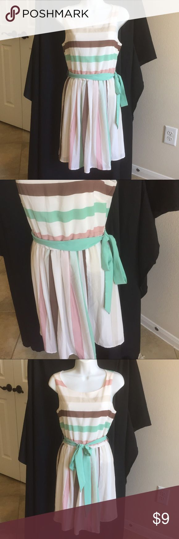 Never worn American Rag Spring Dress I purchased this dress to use for college interviews a few years ago but hit a late growth spurt and couldn't wear it! This cream dress is perfect for spring with it's light and airy fabric. It features a multitude of pastel colors and a built in slip. The mint fabric belt can be tied  in the front, back, or on the side. The zipper goes all the way to mid back for ease in dressing and has a hook at the top to keep it fastened securely on. American Rag…