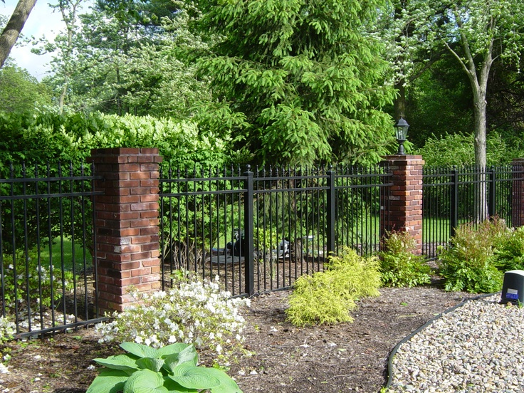 Ornamental Fence With Brick Column Posts