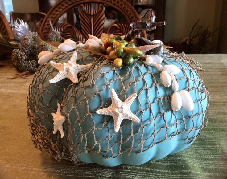 15 of our favorite ideas for this fall! These examples of coastal and beach themed pumpkin decorations are just too much fun!