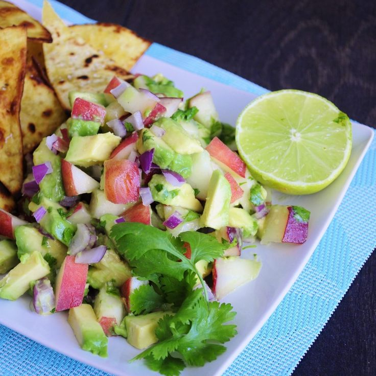 Avocado Peach Salsa Recipe made with fresh healthy coconut oil tortilla chips. Easy to make, vegan, gluten-free, paleo and absolutely delicious! Fast recipe that only takes minutes to make!