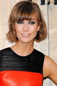 Karlie Kloss gives her bob a retro feel with a heavy fringe and flicked out and under ends. - Woman Magazine