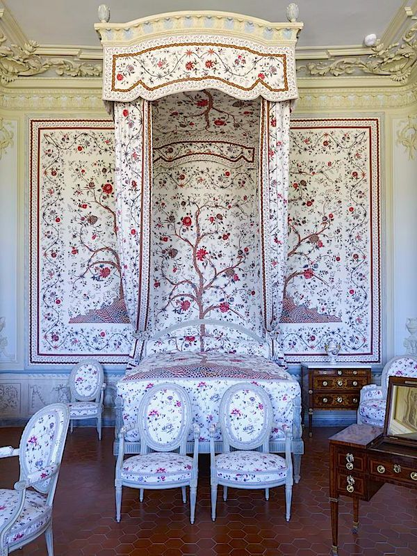 Chateau Borély in Marseille, where a bedroom, below, is totally enveloped in Braquenié's Le Grand Genois,