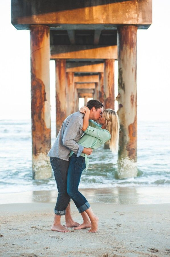 Sean + Kristen's sun kissed engagement pictures in St. Augustine and at the beach pier(Anastasia Island)