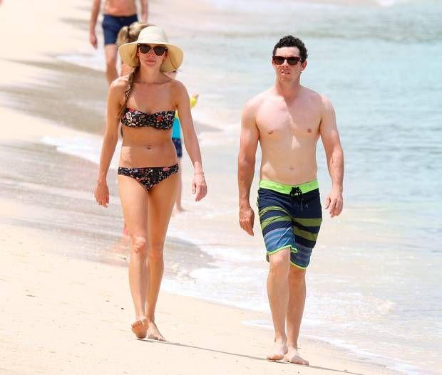 Golfer Rory McIlroy and girlfriend Erica Stoll are pictured at the beach while on holiday in Barbados. Picture: PRIMADONNA/GEMAIRA/Splash News