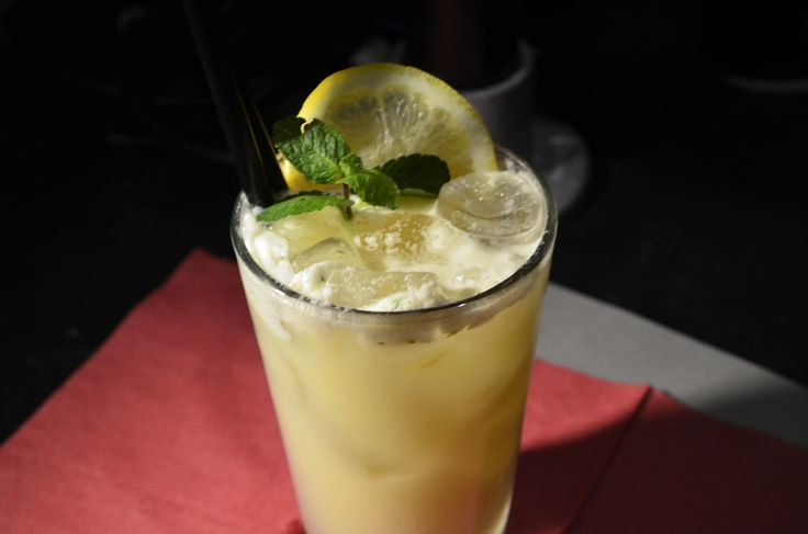 Dansfizz - Gin, Apricot brandy, lemon juice ginger syrup, mint, cream, & ginger beer.