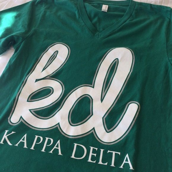 Kappa Delta V-neck T-shirt Kappa Delta Kelly Green V-neck T-shirt with nautilus she'll on the back. T-shirt is Canvas brand. Kappa Delta Tops Tees - Short Sleeve