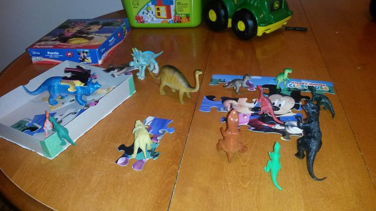 November 12, 2014: The dinos attempt to put together his favourite Mickey Mouse puzzle.