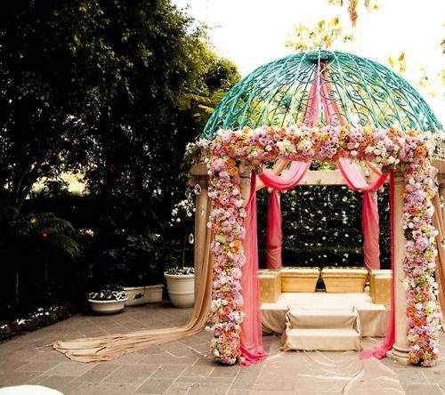 I think these is a beautiful altar, or I guess a place for the bride and groom to sit for indian weddings.