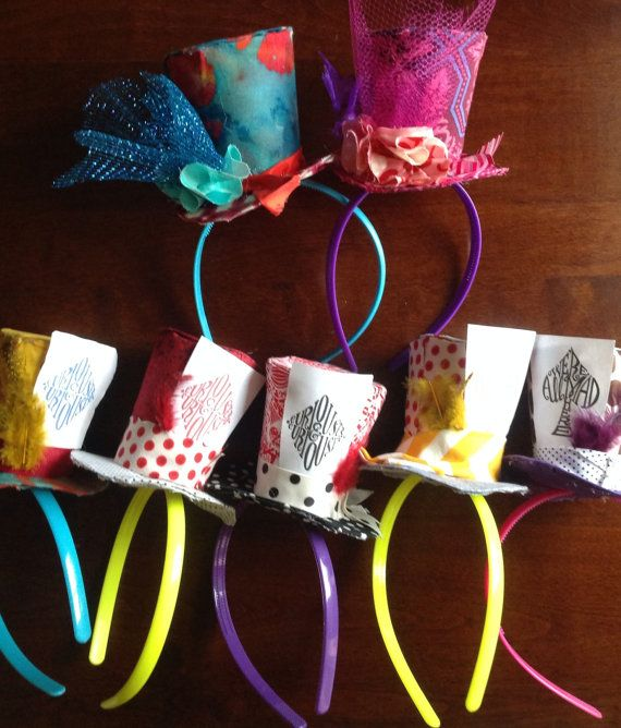 Brei, we could get this for the wedding shower for the guest who don't wear a hat! How cute are they? It come with 7 of them for 15!  Mad hatter party hats by RustyPaisley on Etsy, $15.00