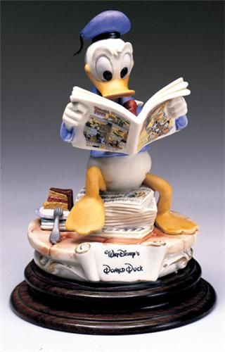 Disney Capodimonte Donald Duck Comic. Donald appears totally absorbed as he reads his latest comic adventures! His irascible personality has delighted Disney fans since 1934 and his debut in the Silly Symphony, The Wise Little Hen. By the year 1938 he even had his own comic strip! Beautifully rendered in the finest porcelain, this fitting tribute to our feathered friend, is so real you can almost hear Donald quack!