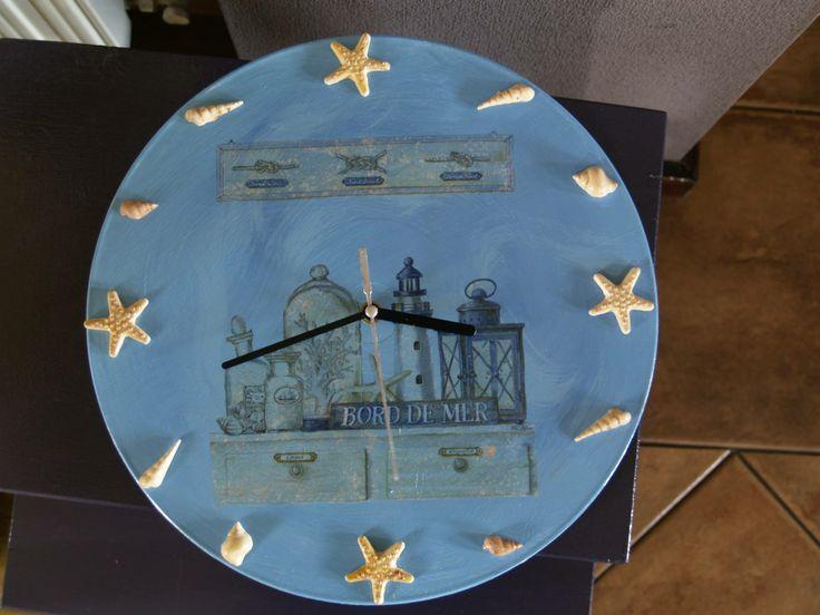 Clock on vinyl (acrylic, decoupage, shells from clay)