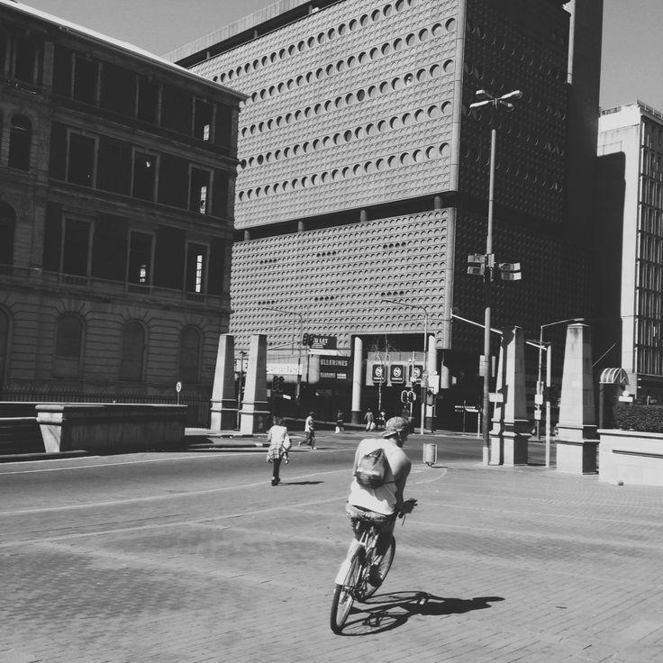 riding through Johannesburg.  weapon of mass creation, minimal, vsco, vsco_minimal, minimalistic, Johannesburg, South Africa, bicycle