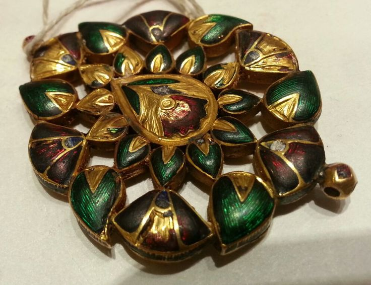 PENDANT (Padakkam) Reverse enamelled with flower designs. XIX Century. India