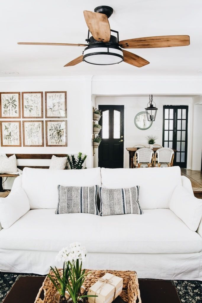 Love the 6 wooden frames - would do black and white candid photos of family. And I like the ceiling fan.