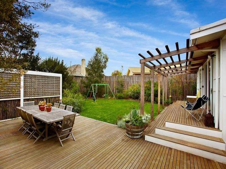 nice deck with angled pergola via desire to inspire