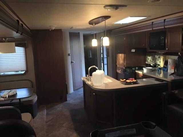 2015 Used Dutchmen COLEMAN Travel Trailer in California CA.Recreational Vehicle, rv, This beautiful pre-loved travel trailer features a rear entertainment area with fireplace, sleeper sofa with opposing lounge chairs. The DINING TABLE WITH seating for 4 is across from kitchen. The bath has an entry from the front queen bedroom or the hall. The kitchen features beautiful solid surface counters with a peninsula double sink for increased counter space. Frameless tinted windows make the exterior…
