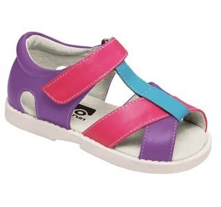 See Kai Run always create the brightest, funnest kids shoes, with great soft leather and flexible soles that allow your child's foot to move as naturally as possible.  This sandal is bright and breezy! She'll be unmistakable in these hot pink, purple and blue strappy sandals with a white rubber sole. Also available in Silver.