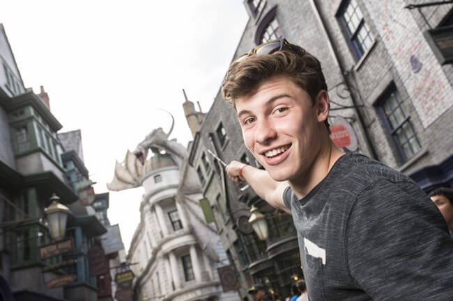In this handout photo provided by Universal Orlando Resort, singer Shawn Mendes visits The Wizarding World of Harry Potter Diagon Alley at Universal Orlando on May 24, 2015 in Orlando, Florida. He explored Diagon Alley and even tried his hand at casting a spell or two....