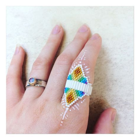 .:. Talismán de Arco Iris .:. Newly woven Spectral Temple ring ~ Vibrant + soft at the same time .. Rainbow light Weaver .. Inspired by the winged, Amazonia, serpiente, Colibrí, Temples, the Ancients   One of a kind + woven with Love + Prayer.  On Sale was 50.00 now 40.00