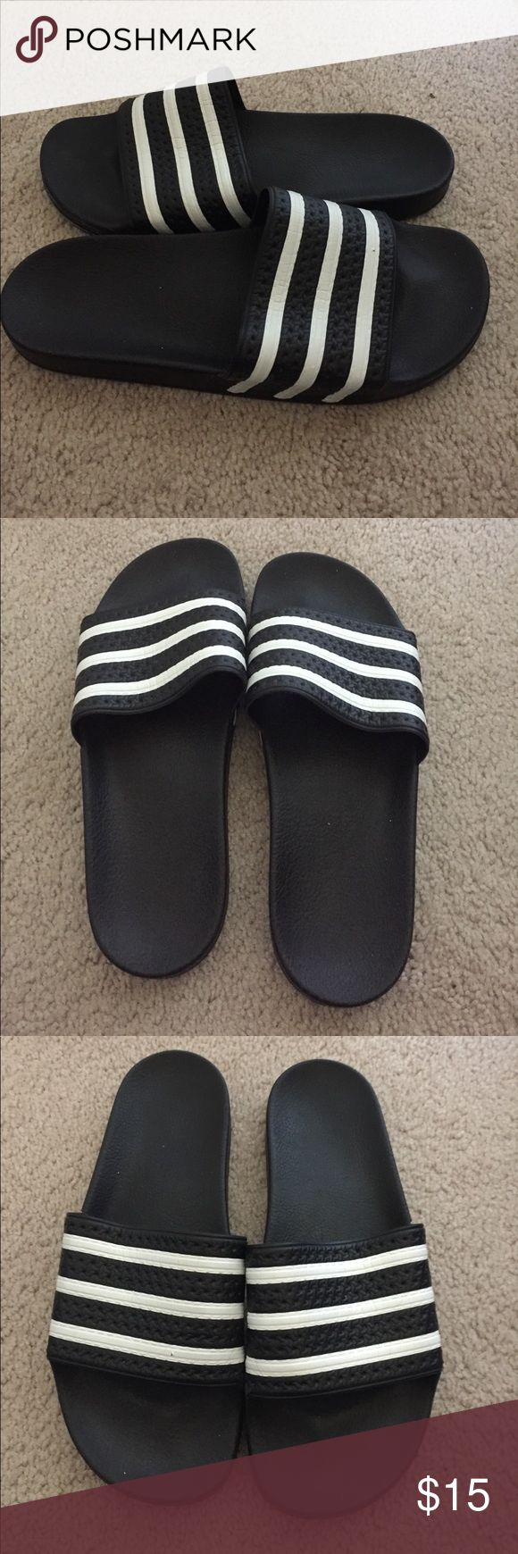 Adidas Flip Flops Black and white, size 11. Worn but pretty good condition. The top doesn't have the same form as it used to but it does not appear that way when on the foot. adidas Shoes Sandals & Flip-Flops