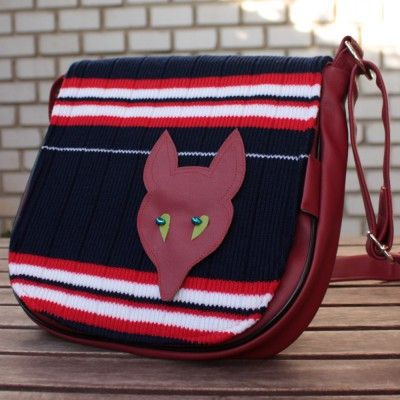 Practical bag with knit flap and nice foxy brooch.