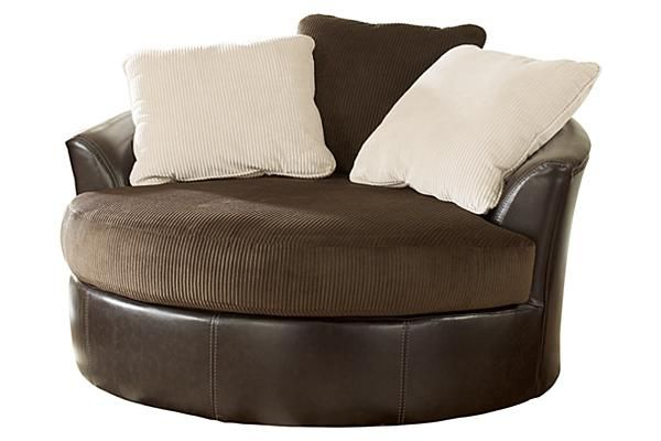 "The Victory - Chocolate Oversized Swivel Chair from Ashley Furniture HomeStore (AFHS.com). The rich upholstery fabrics along with the plush contemporary design makes the ""Victory-Chocolate"" upholstery collection the perfect addition to enhance the style of any living room decor."