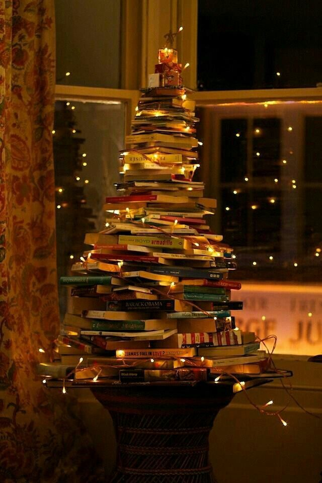 I think I'll  do this for  one of my Yule 'trees' but with different shades of red vintage books